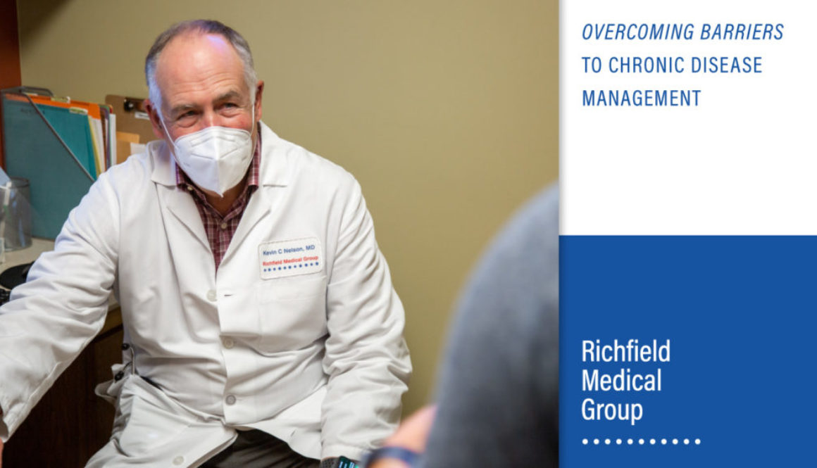 "Doctor sitting with patient, ""Overcoming Barriers to Chronic Disease Management"" by Richfield Medical Group"